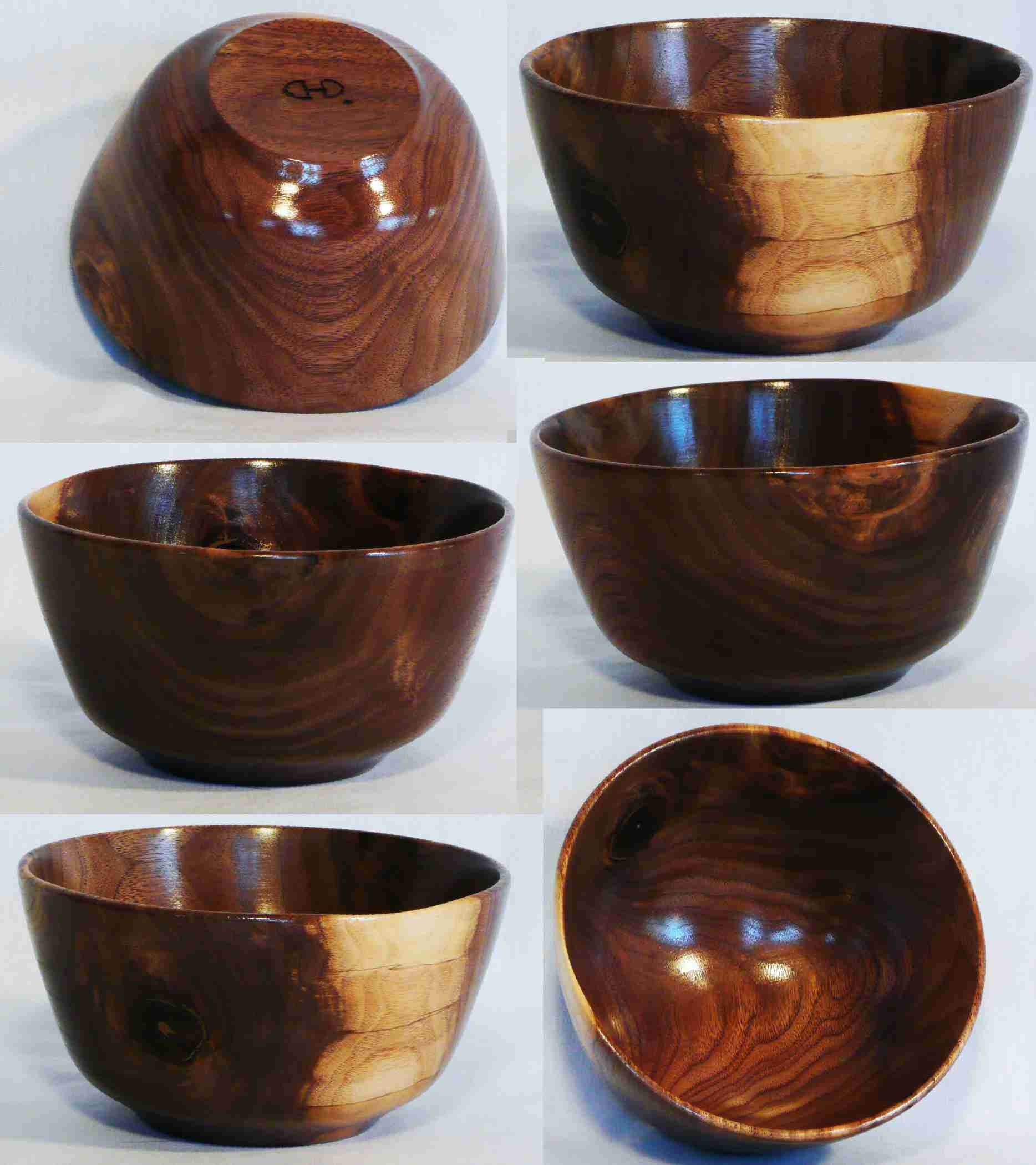 Walnut bowl hand turned by Cynthia D. Haney with decorative accent from a knot and sapwood.