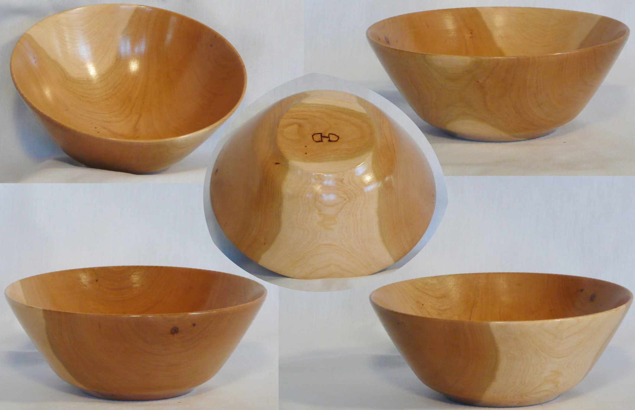 Hand turned Cherry bowl accented by sapwood on two sides by Cynthia D. Haney.