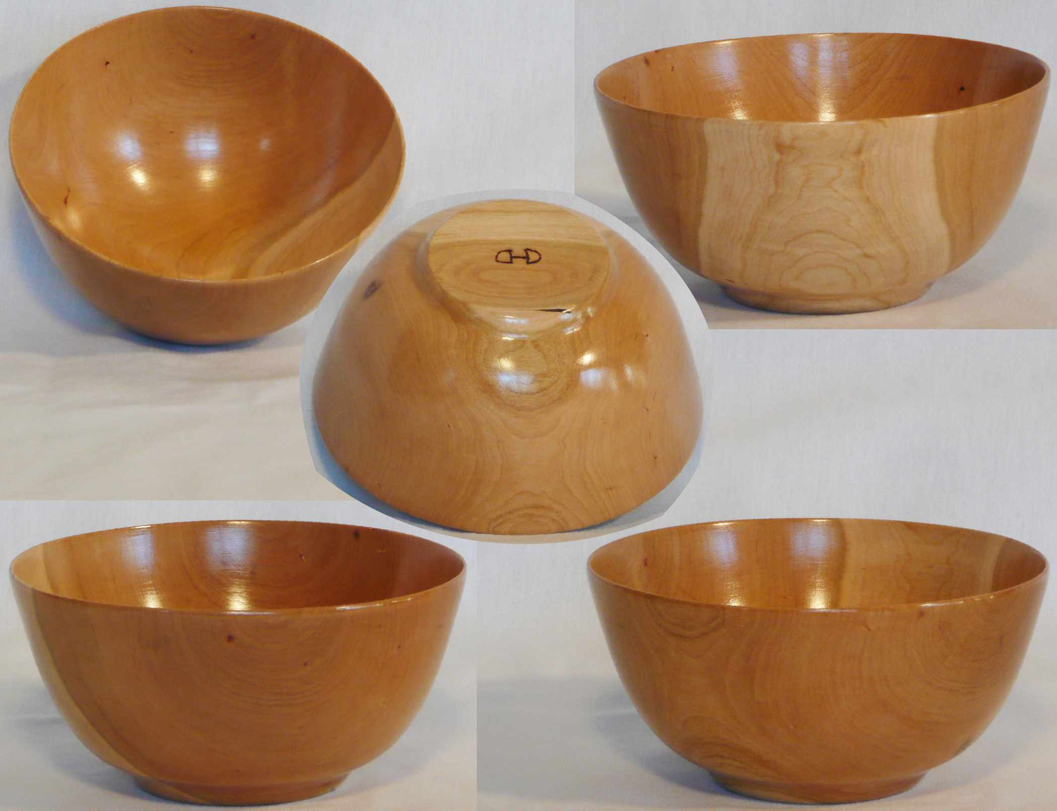 Hand turned cherry bowl with sapwood accent on one side by Cynthia D. Haney.
