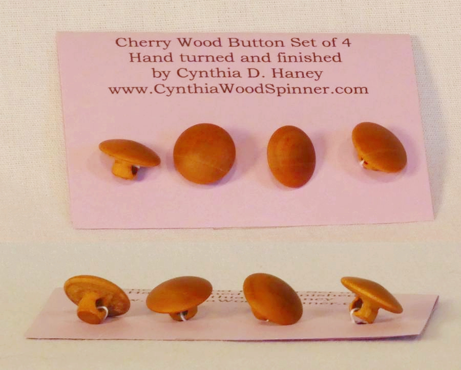 Handmade wooden button from Cherry wood by Cynthia D. Haney small set of four.  For sale.