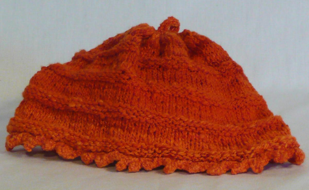 Orange hat knit by with yarn spun by Cynthia D. Haney.  The fiber was dyed by Unplanned Peacock.