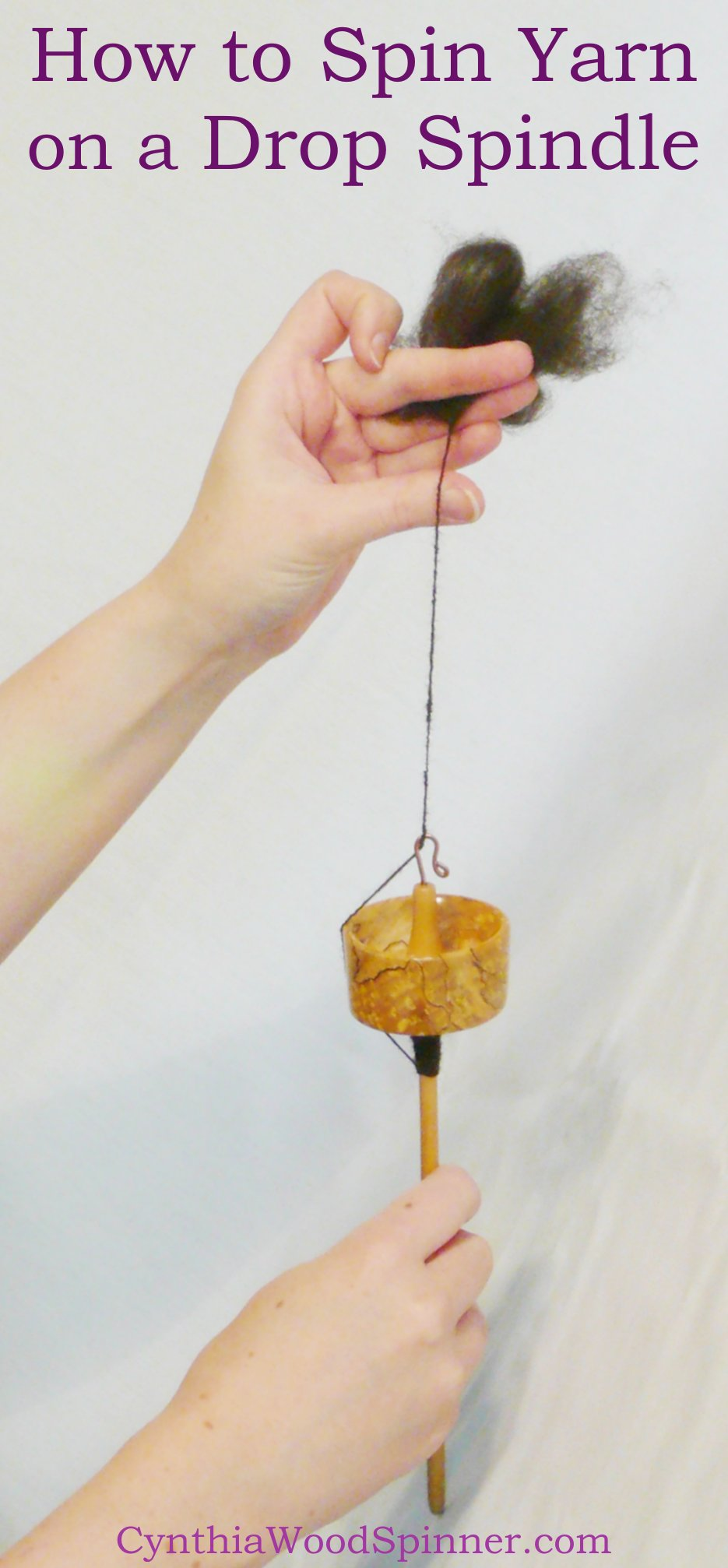 Top whorl drop spindle handcrafted by Cynthia D. Haney being used to make yarn.