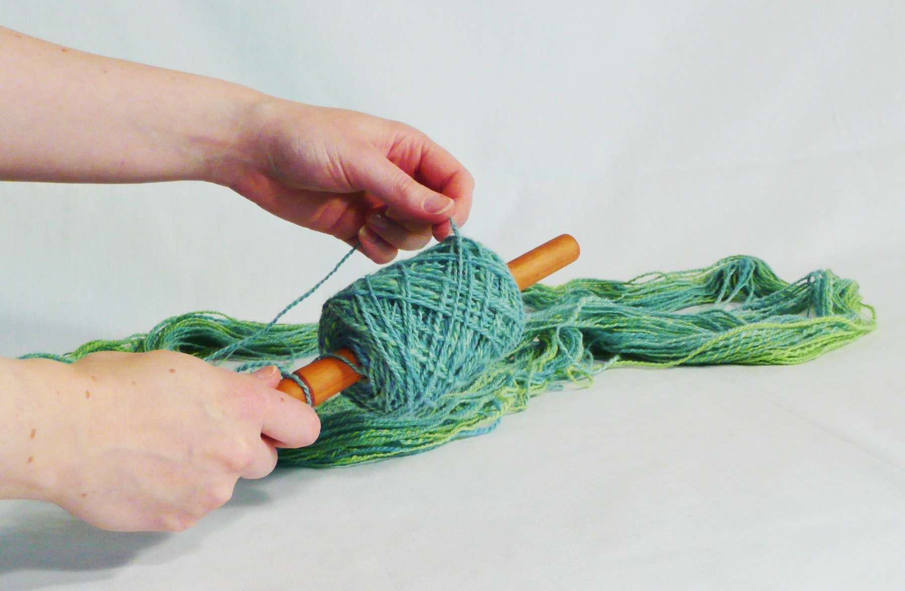 DIY yarn ball winding on a nostepinne.  How do I work with a hank of yarn. Step 11.