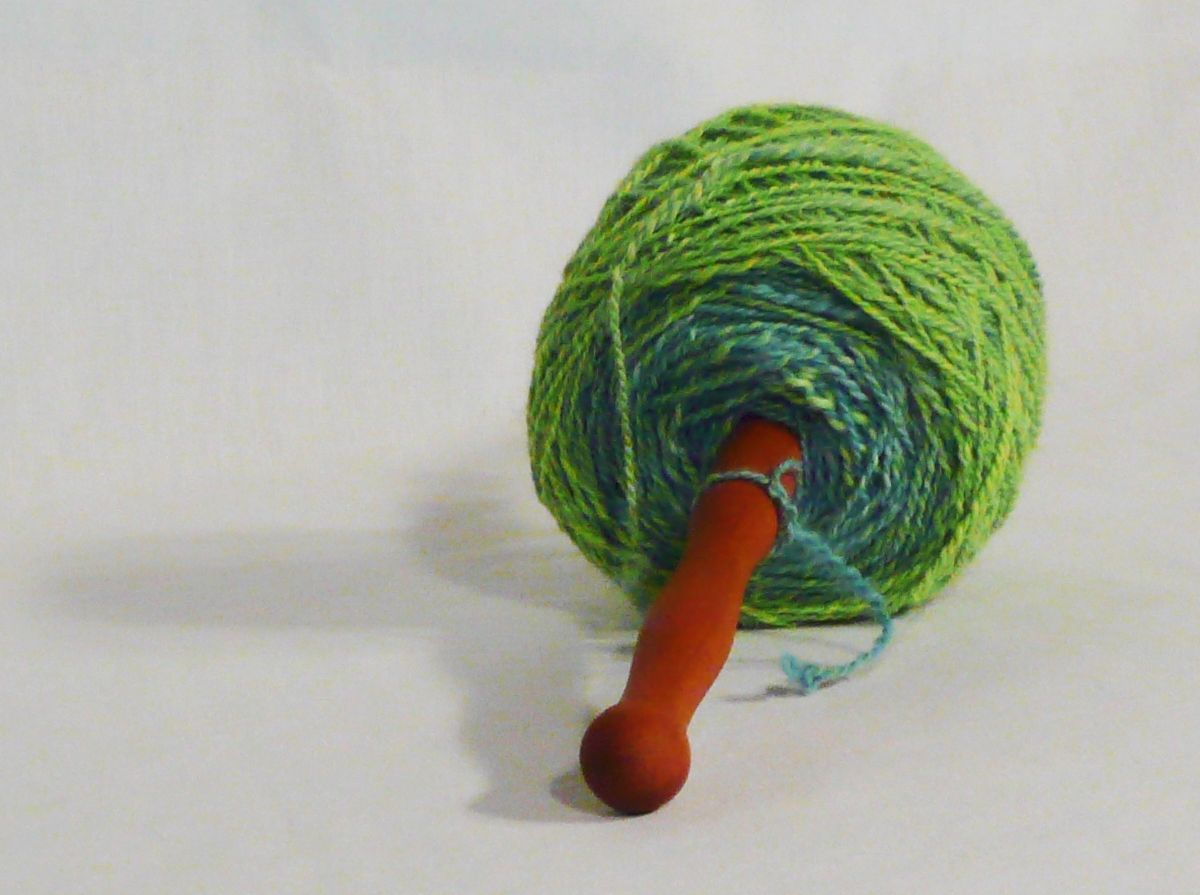 How to hand wind a center pull ball of yarn on a nostepinne.  Guide step 13. Finishing steps.