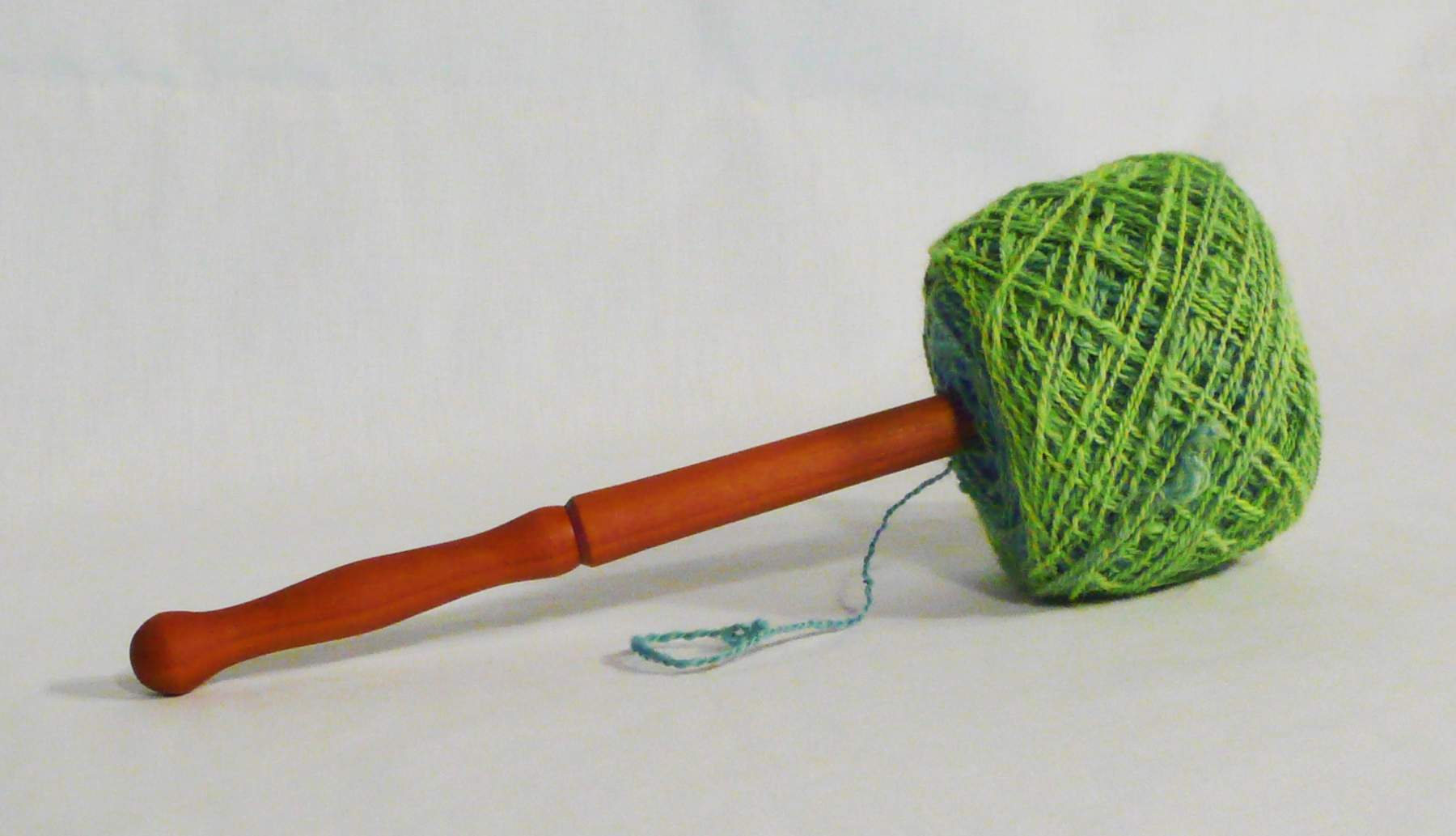 A freshly wound yarn cake coming off the nostepinne.  Last step in the how to guide.