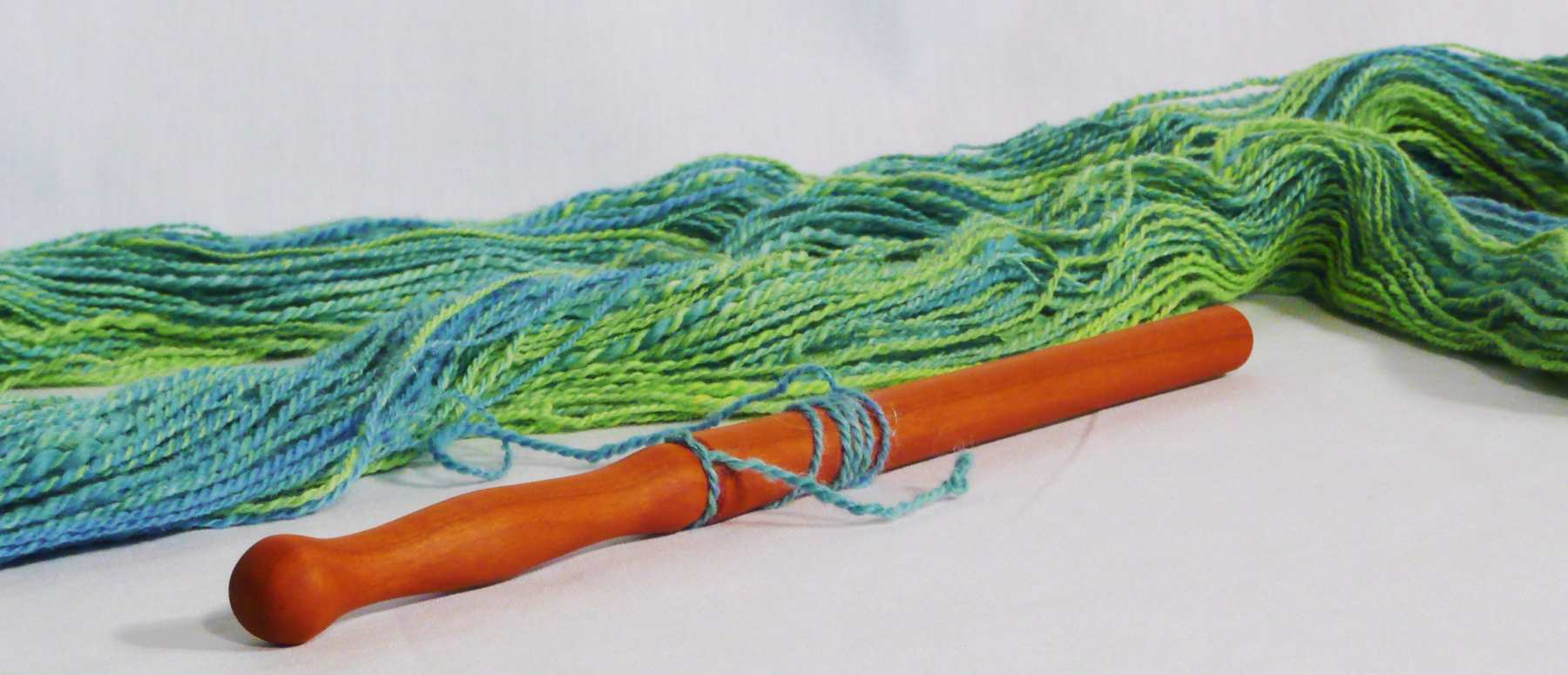 How to use a Nostepinne second step.  Wind perpendicular to the shaft of the nostepinne from the skein of yarn
