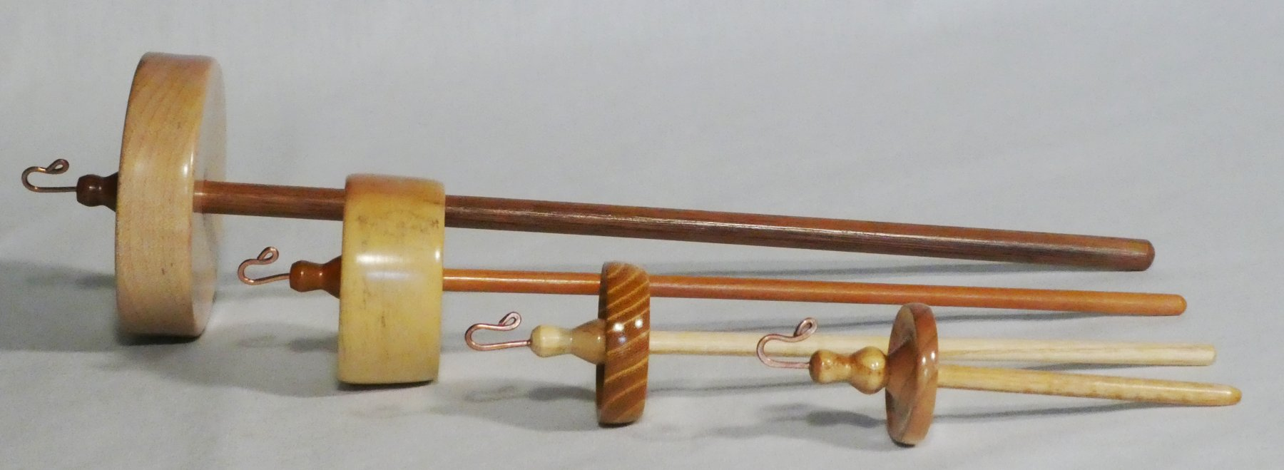 The range of drop or suspended spindle sizes handturned by Cynthia D. Haney