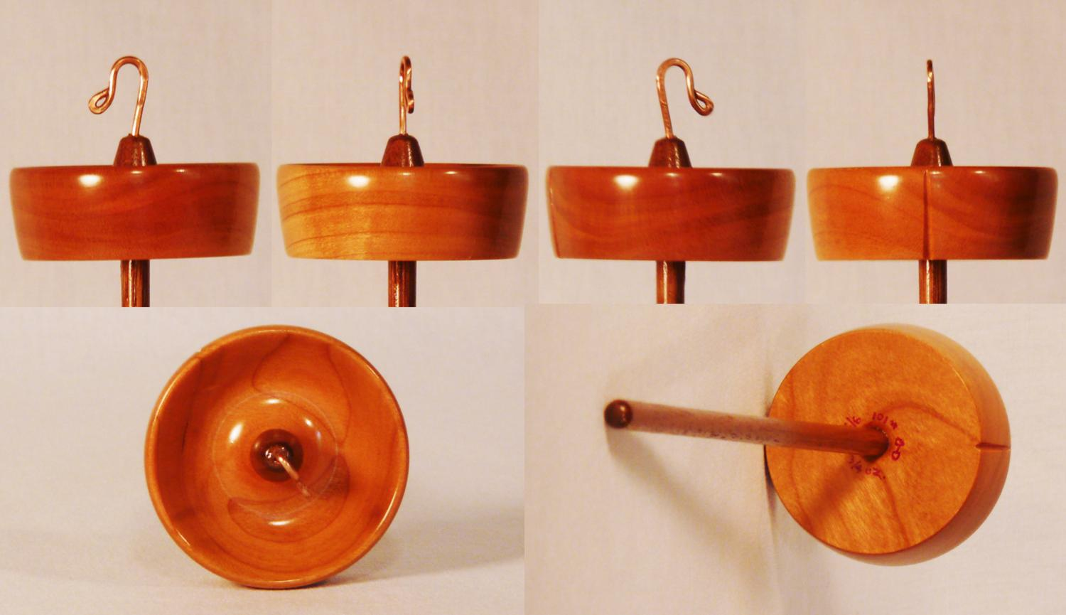 Hand turned top whorl notched drop spindle by Cynthia Haney of Cherry on a Walnut shaft
