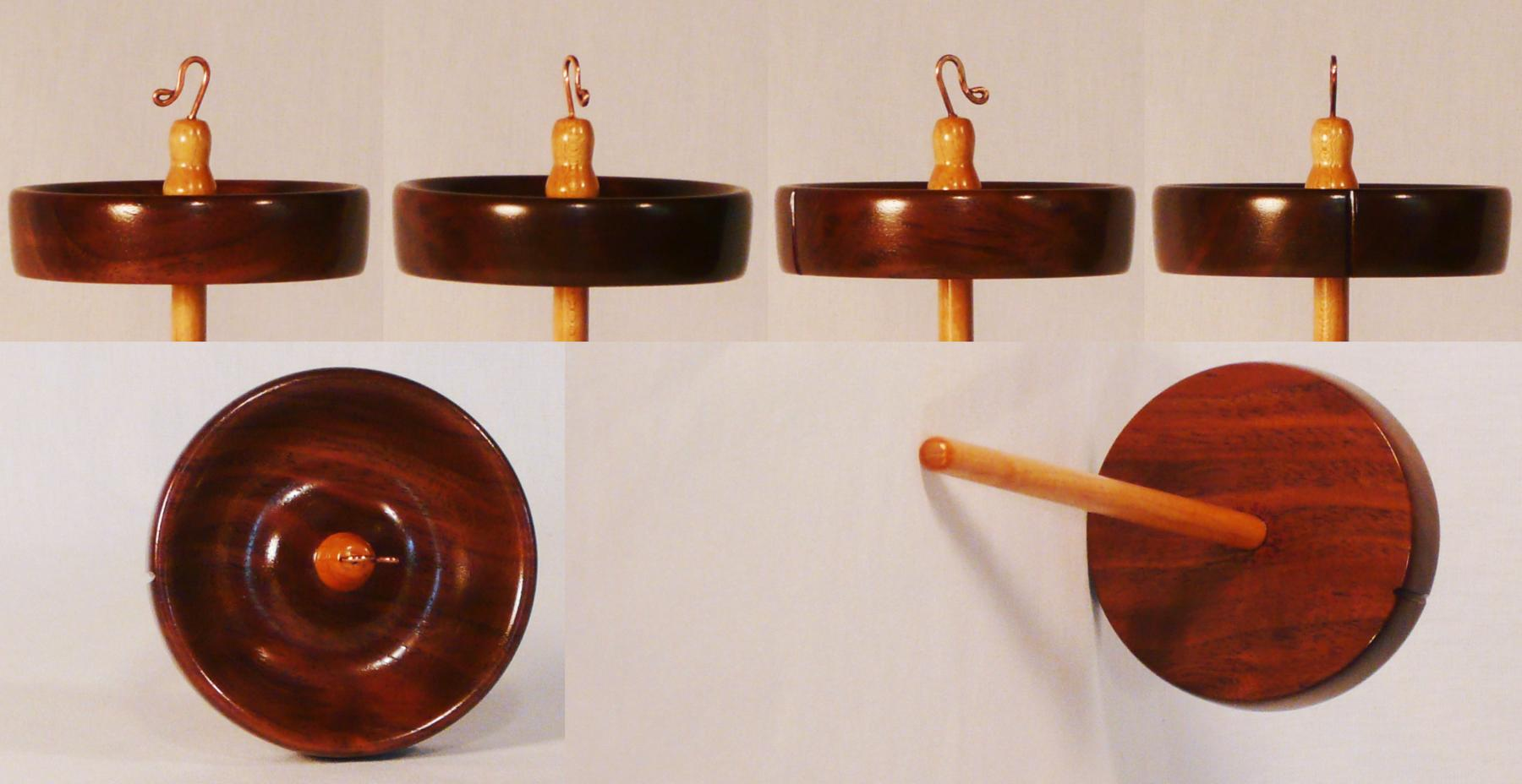 Hand turned high whorl notched drop spindle for spinning yarn by Cynthia D. Haney of Walnut and Maple woods.