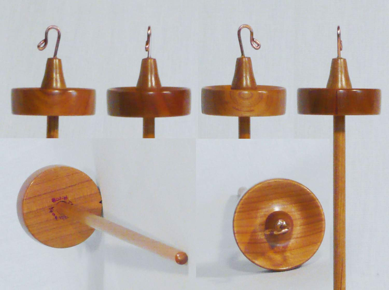 Hand turned high whorl notched drop spindle for spinning yarn by Cynthia D. Haney of Cherry wood.