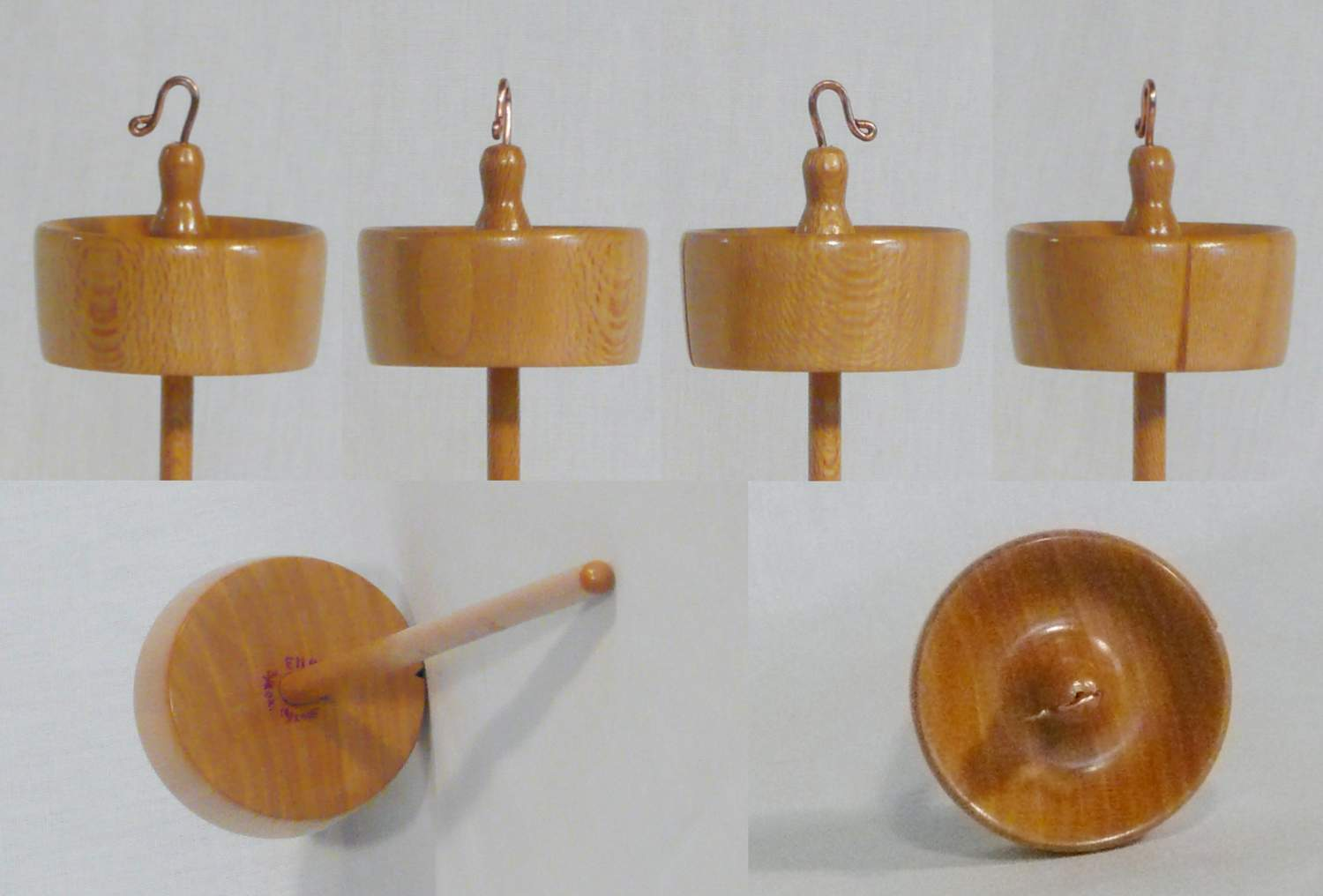 Hand turned high whorl notched drop spindle by Cynthia D. Haney of Sycamore wood.