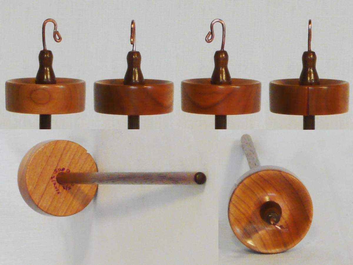 Hand turned top whorl drop spindle by Cynthia D. Haney of Cherry on Walnut 1/2 oz. Not for Sale