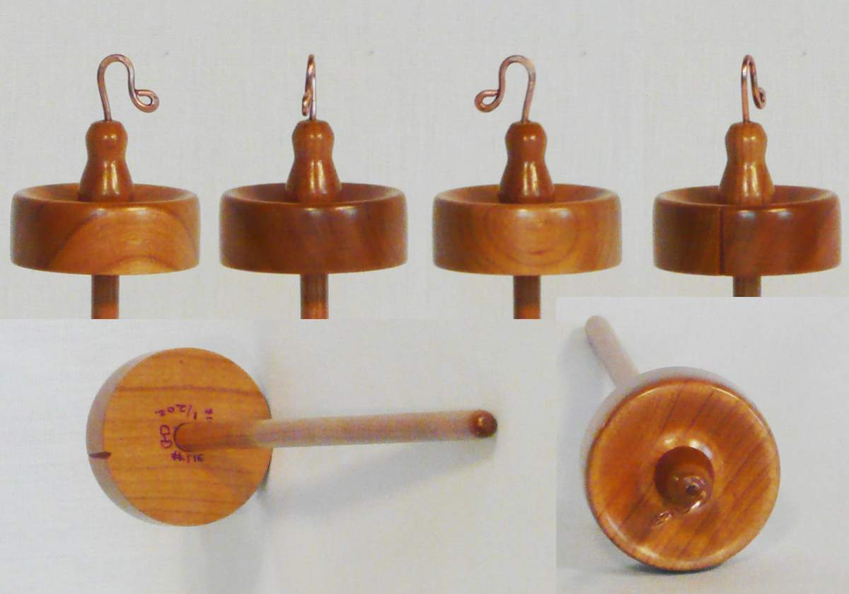 Top whorl drop spindle of Cherry wood.  Hand turned by Cynthia D. Haney 1/2 oz.