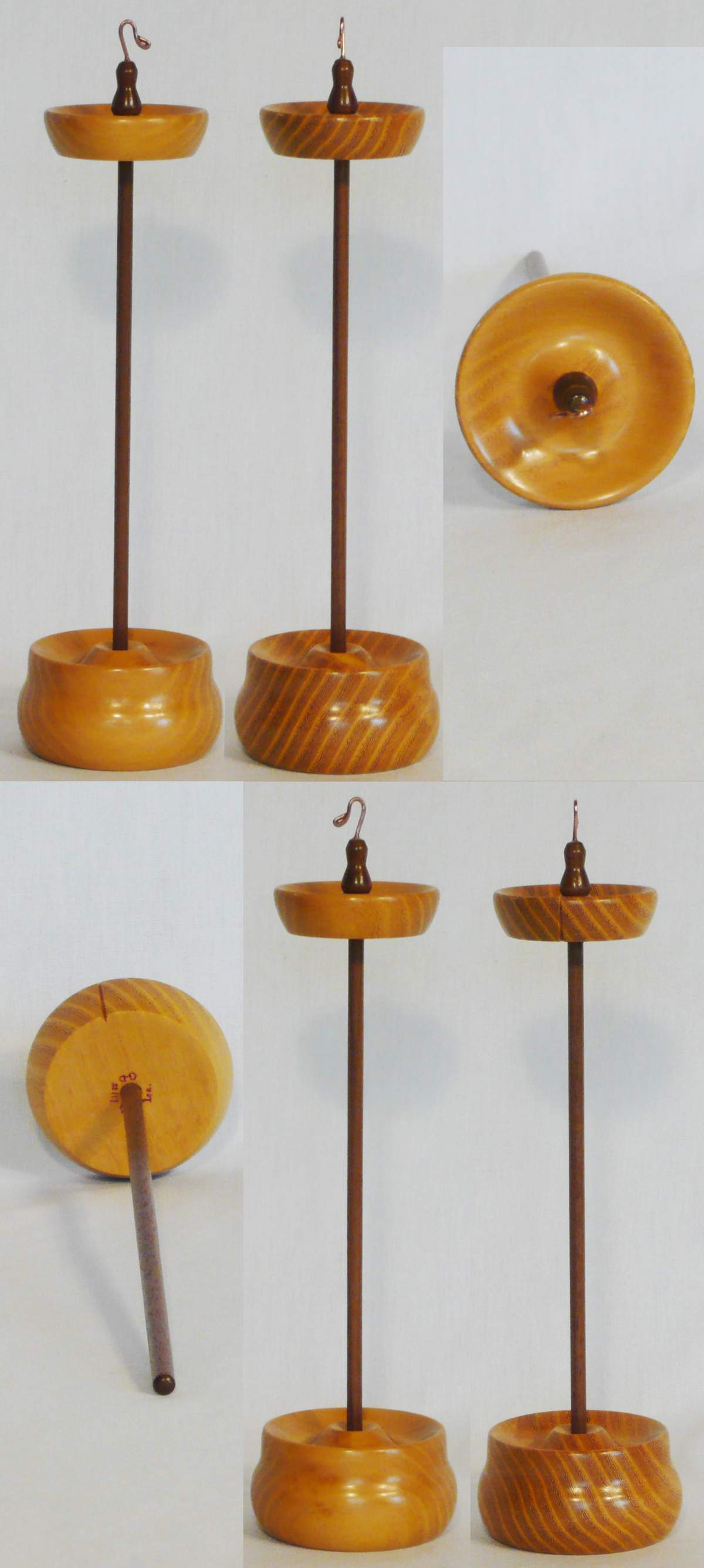 Top whorl drop spindle of Osage Orange wood on a Walnut shaft with a matching display stand. Hand turned by Cynthia D. Haney 1 oz.