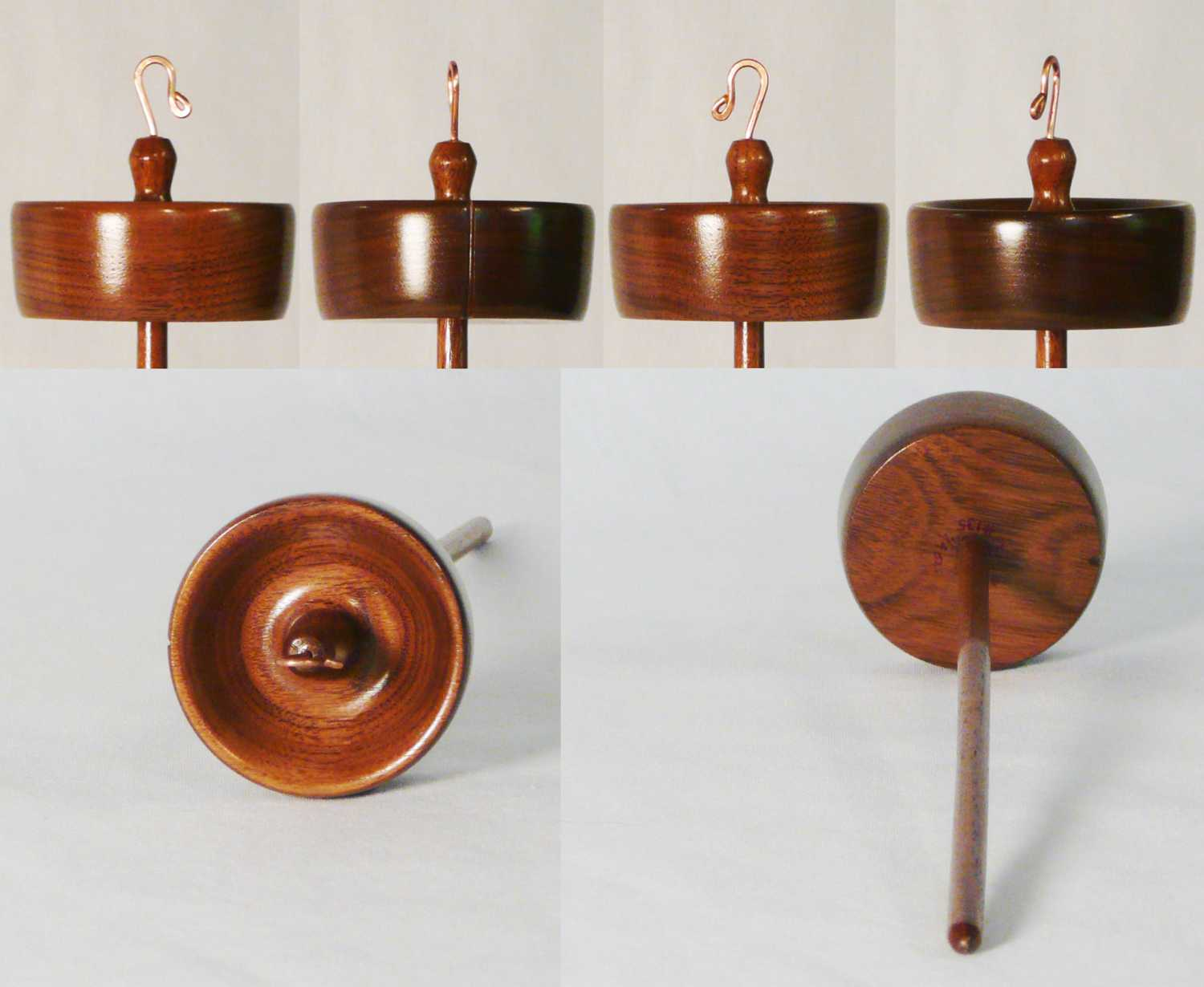 Walnut drop spindle hand turned by Cynthia D. Haney, her 135th.  High, top whorl, weight 3/4 oz.