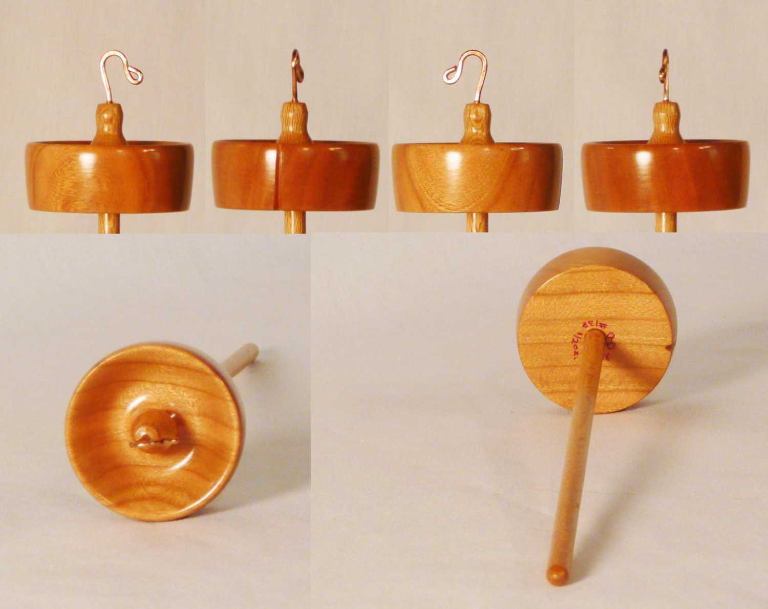 Cynthia D. Haney turned this drop spindle from Cherry and Sycamore woods, signed and numbered 138, weighing 1/2 oz.