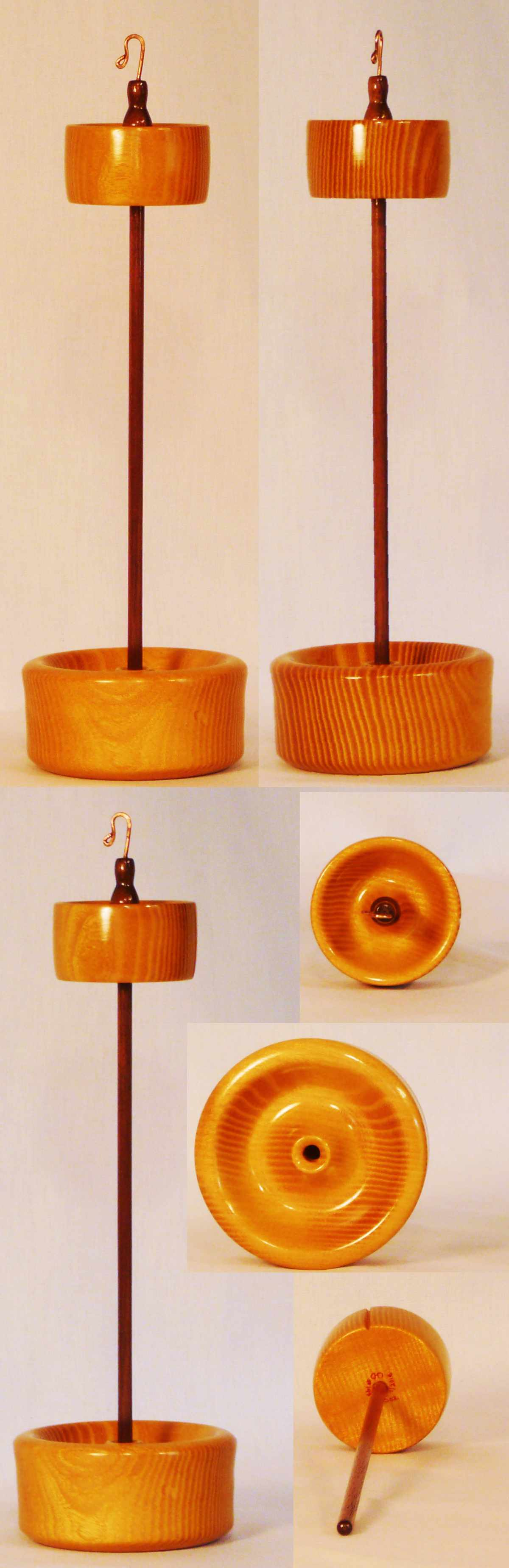 Top whorl drop spindle and matching display stand in Osage Orange on a Walnut Shaft.  Signed number 144 by Cynthia D. Haney