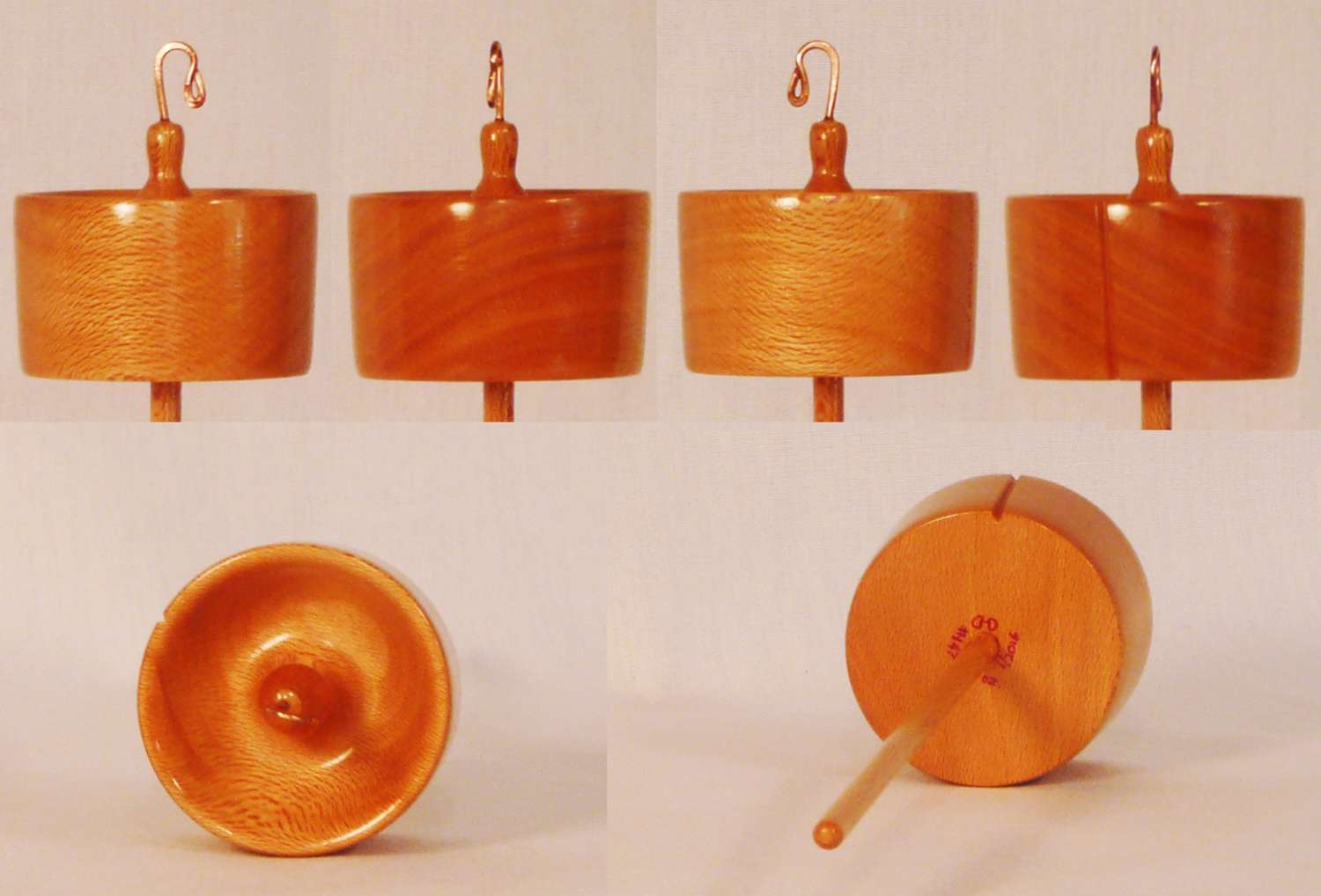 Top whorl drop spindle hand turned from Sycamore by Cynthia D. Haney Signed number 147 weight 1 oz.