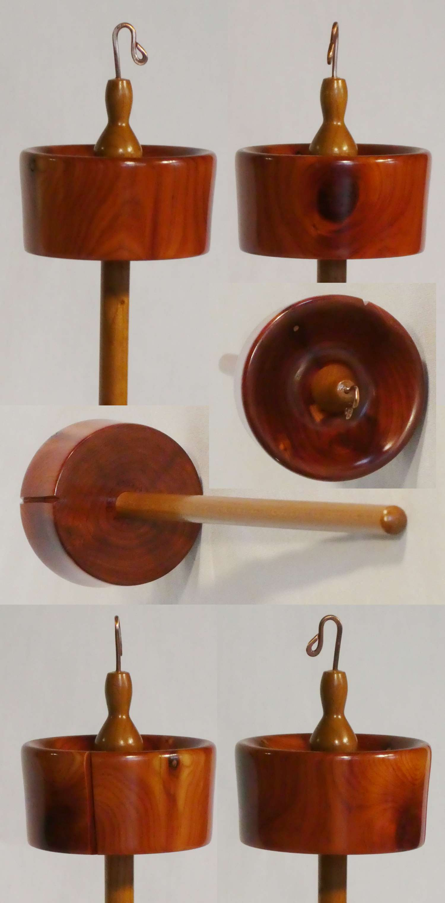 Top whorl drop spindle hand turned from cedar on a cherry shaft by Cynthia D. Haney.
