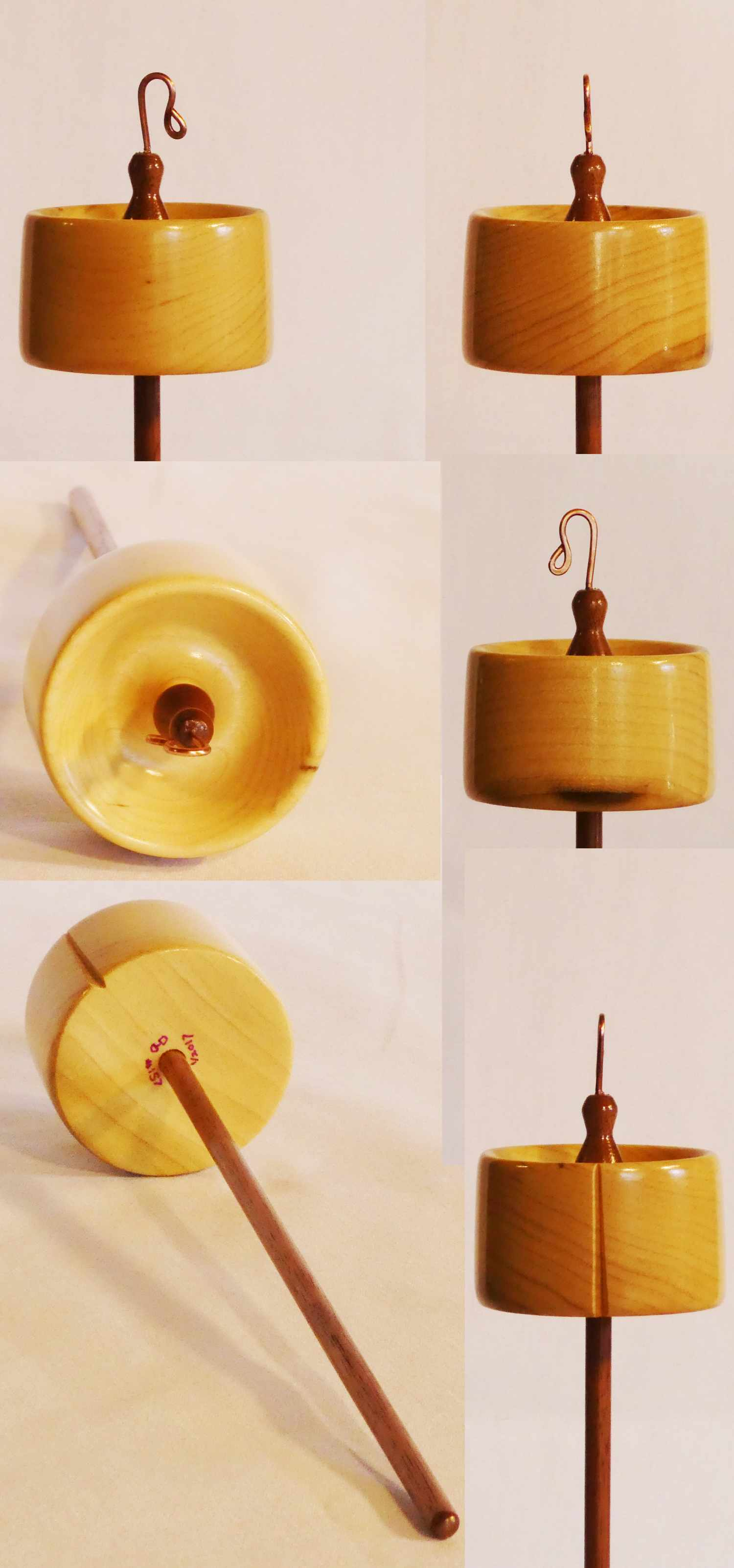 Handcrafted top whorl drop spindle turned from Tulip poplar and Walnut by Cynthia D. Haney.  Signed number 157 weighs 1 oz.