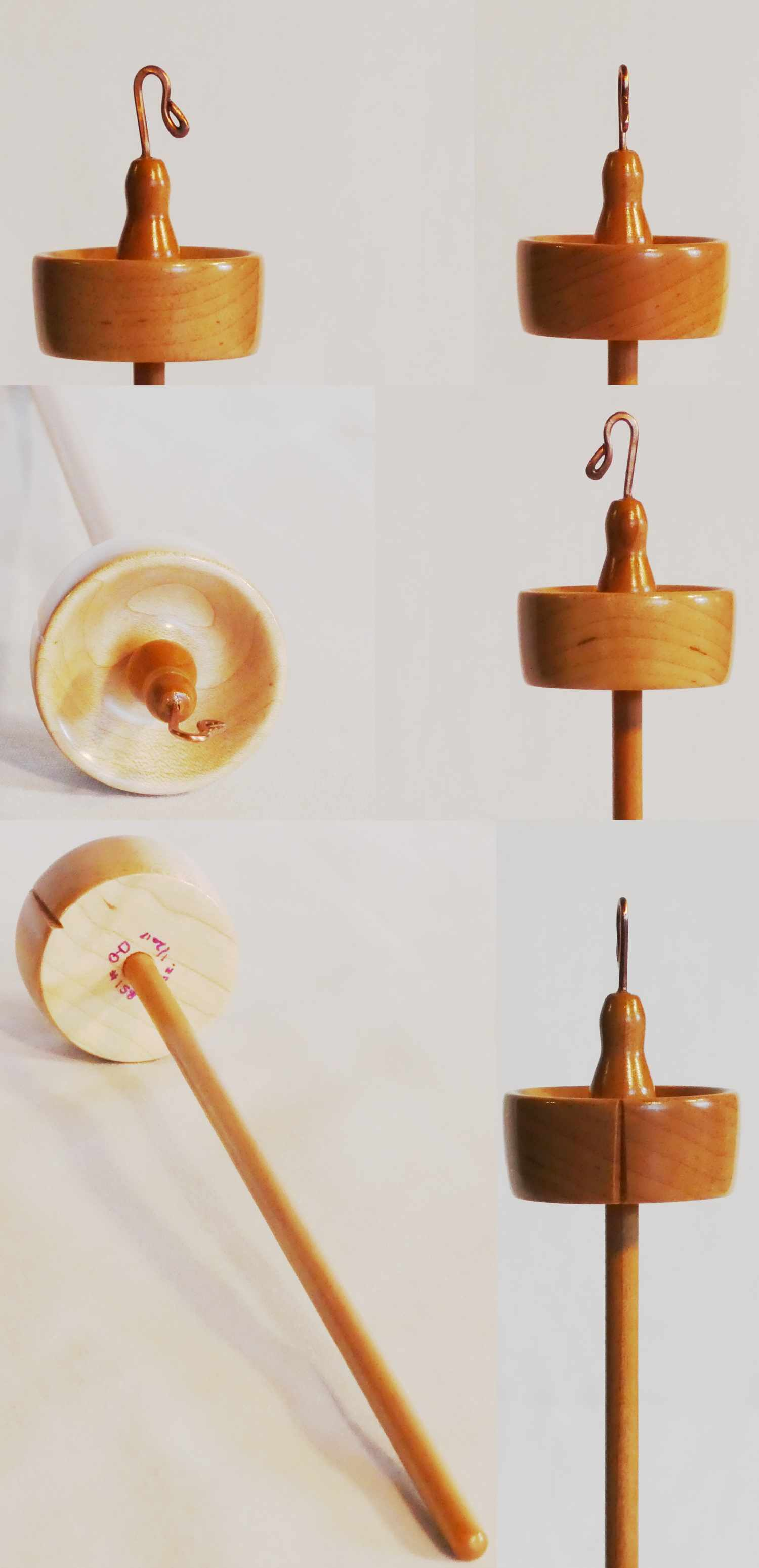 Top whorl drop spindle handcrafted by Cynthia D. Haney in Quilted Maple and Cherry, signed number 158 weighing 0.5 oz.
