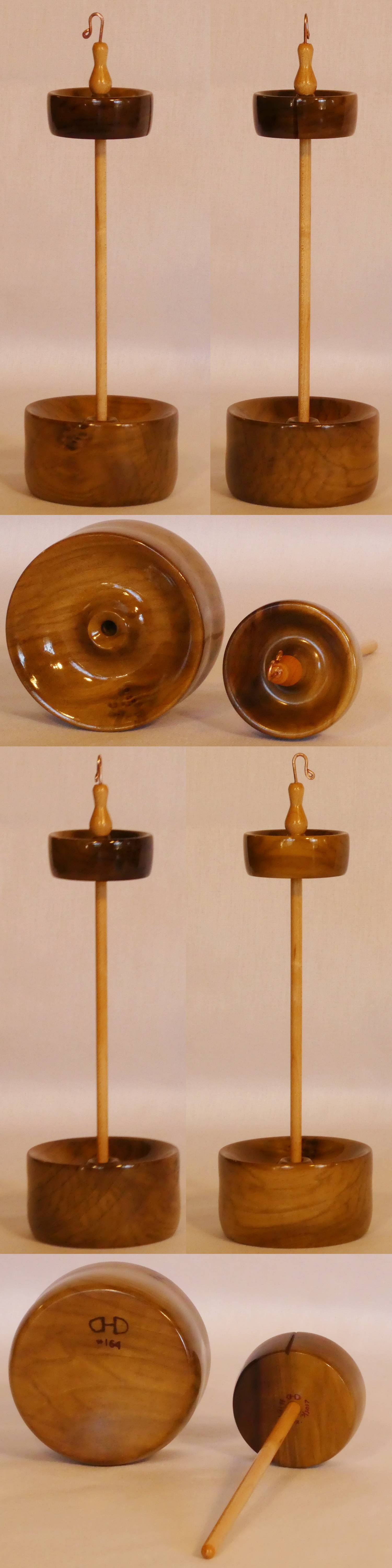 Handcrafted top whorl drop spindle in a display stand, hand turned from Tulip Poplar and Maple wood by Cynthia D. Haney.
