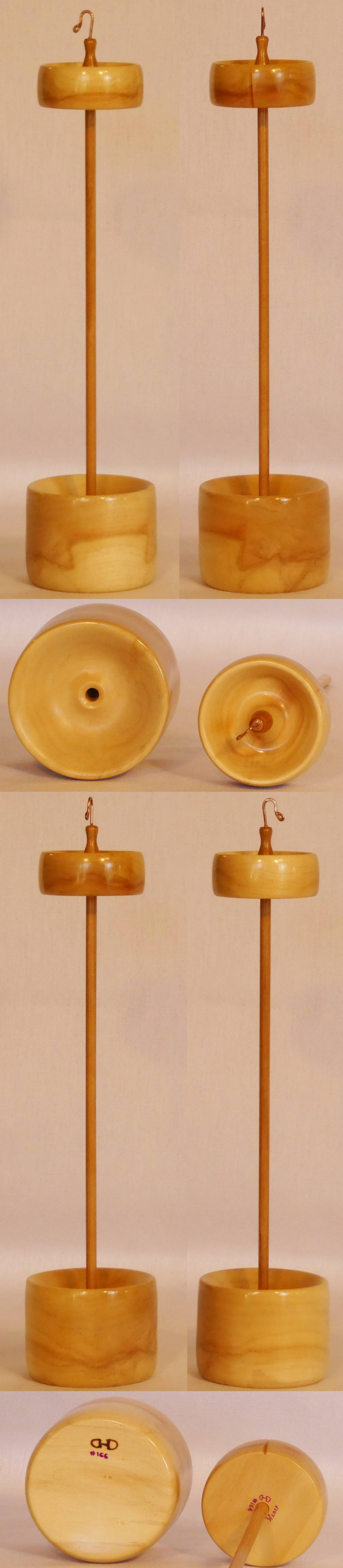 Handcrafted top whorl drop spindle and display stand, hand turned from Boxelder and Cherry wood by Cynthia D. Haney.