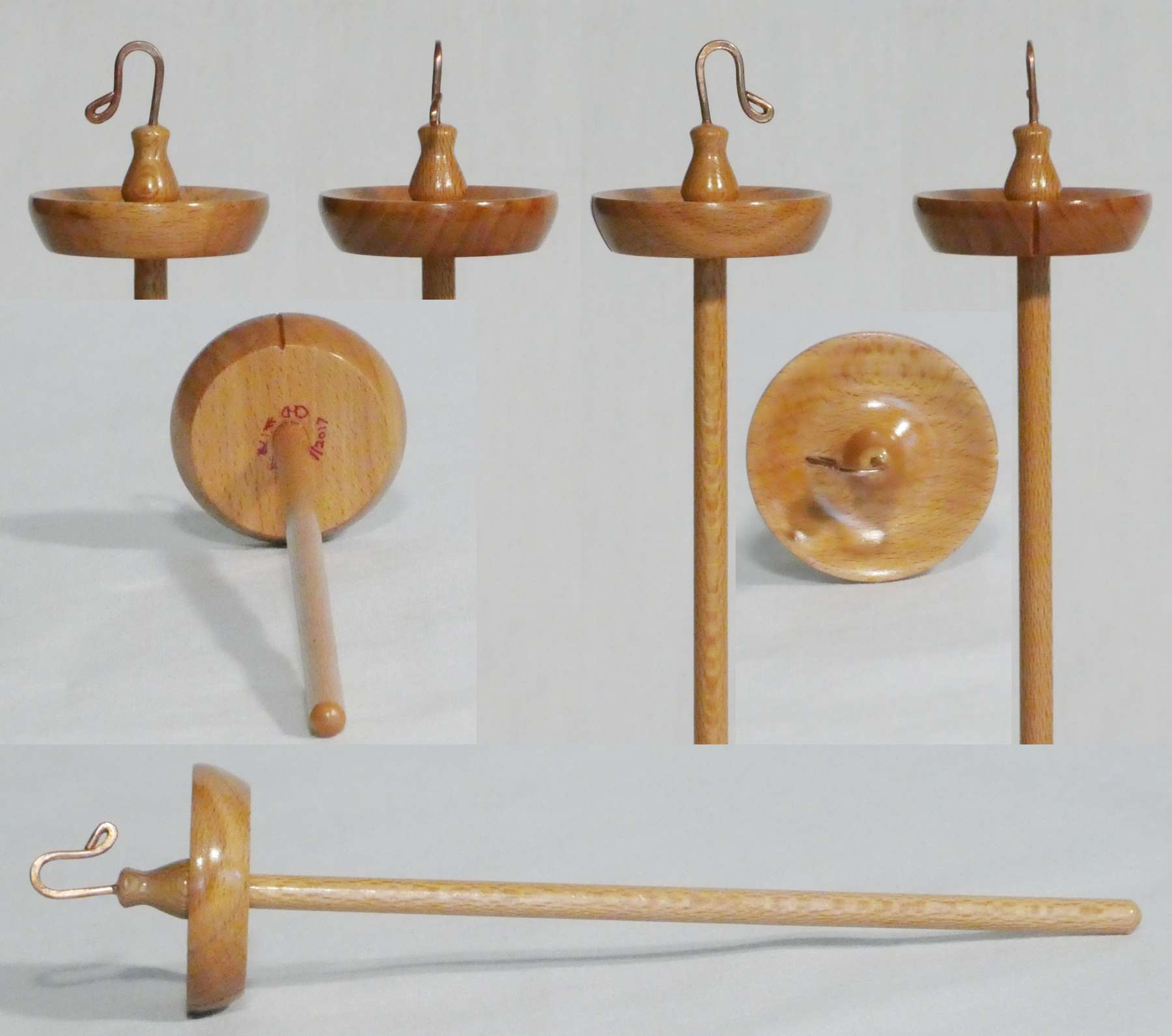 Top whorl drop spindle hand turned from Beech and Sycamore signed number 178 by Cynthia D. Haney.