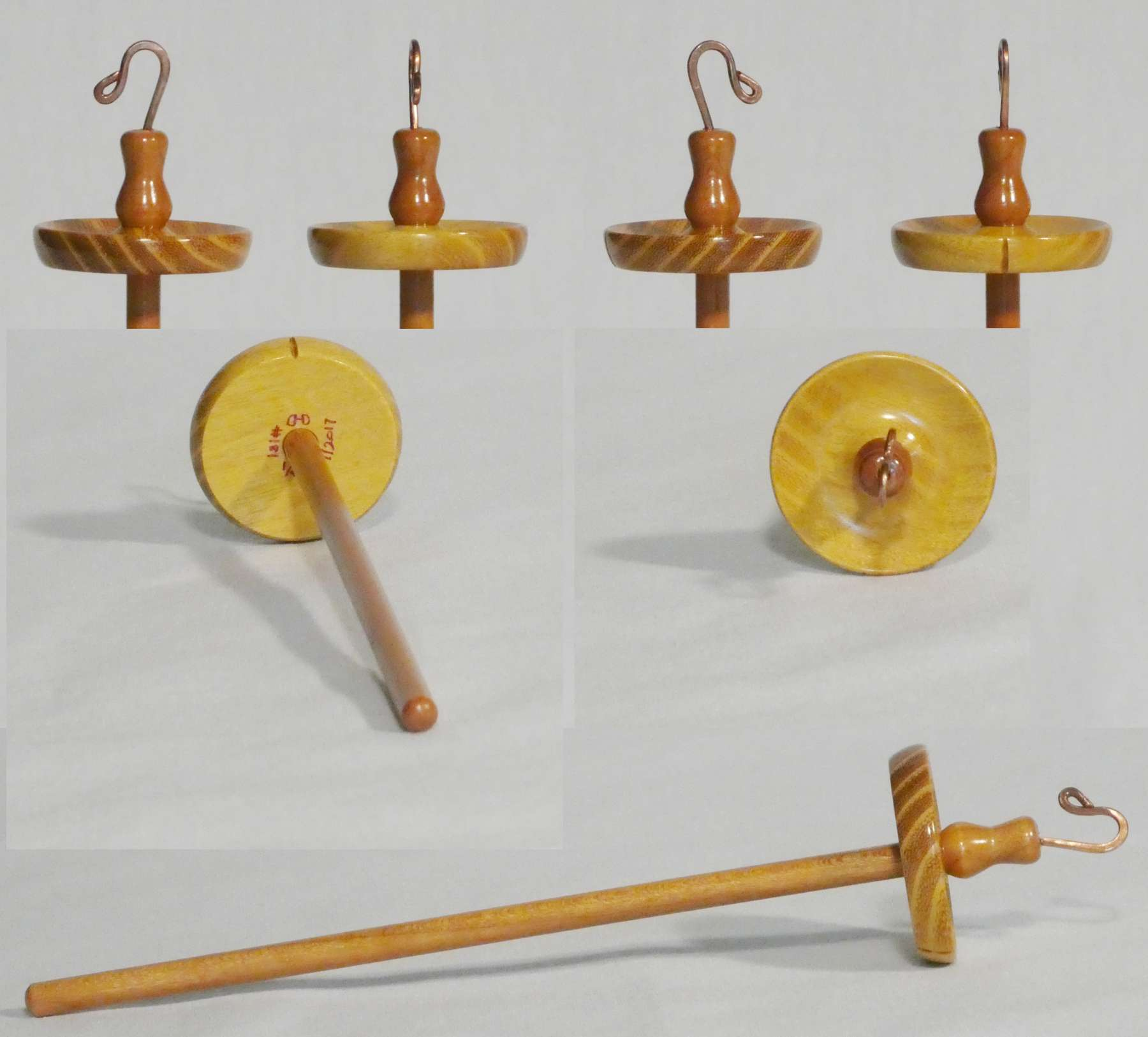 Top whorl suspended spindle for spinning lace weight yarn; hand turned from Osage Orange and Cherry wood with custom hook by Cynthia D. Haney signed number 181.