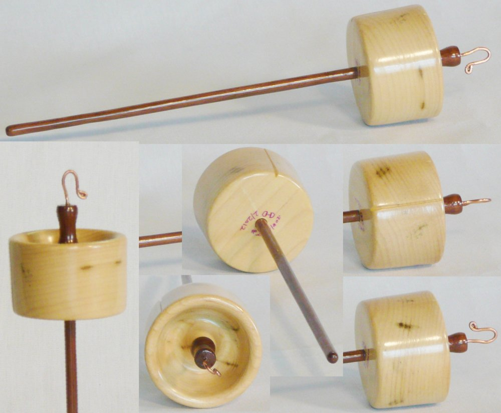 tulip poplar whorl on walnut shaft rim weighted top whorl drop spindle by Cynthia Haney