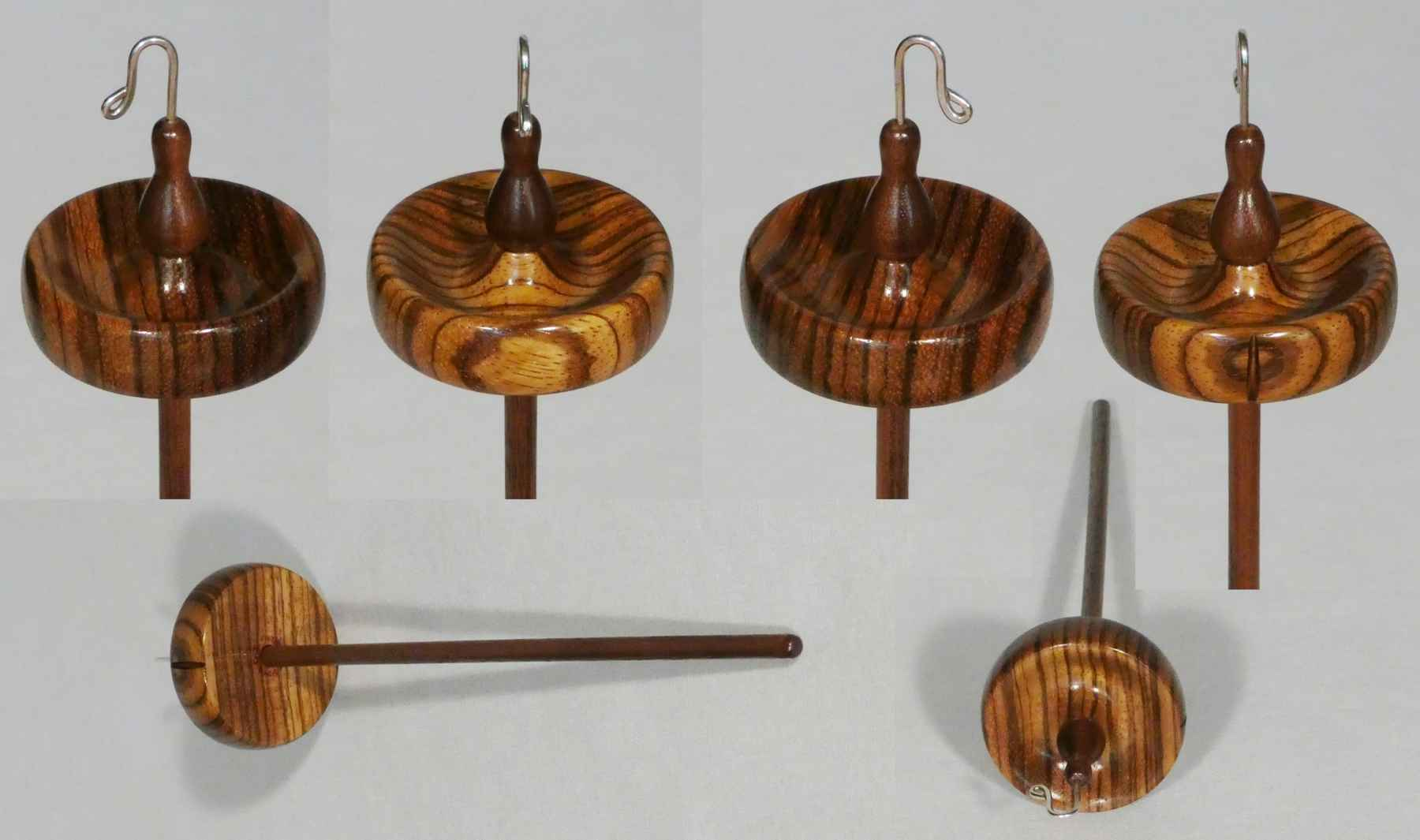 Luxury top whorl drop spindle handturned by Cynthia D. Haney from Zebrawood and Walnut with a Sterling Silver hook.