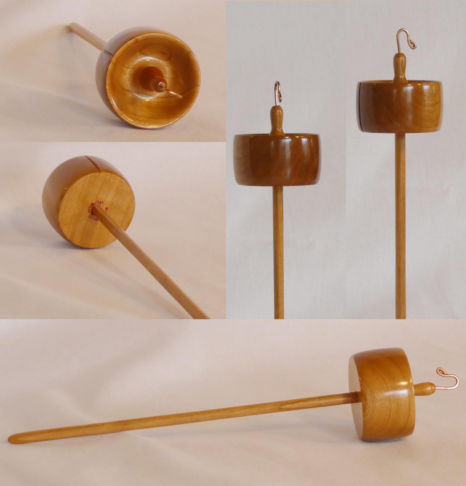 Top whorl drop spindle handturned from Cherry wood by Cynthia D. Haney of Cynthia Wood Spinner signed number 217 with notch and handmade hook.
