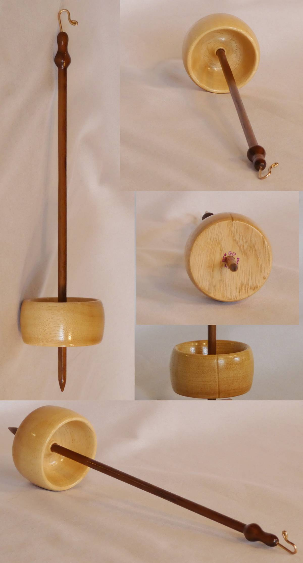 Low whorl suspended drop spindle handturned and made by Cynthia D. Haney from Hickory and Walnut.