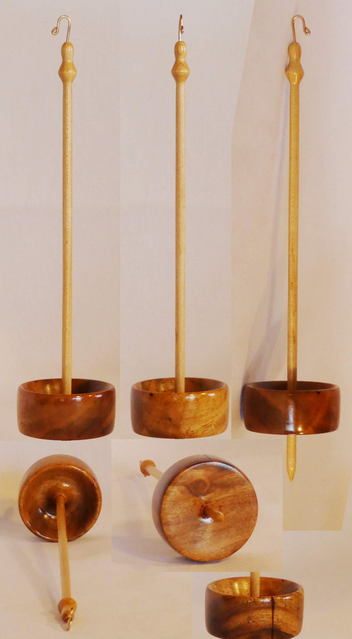 Low whorl suspended drop spindle turned and handmade by Cynthia D. Haney from Figured English Walnut and Maple.