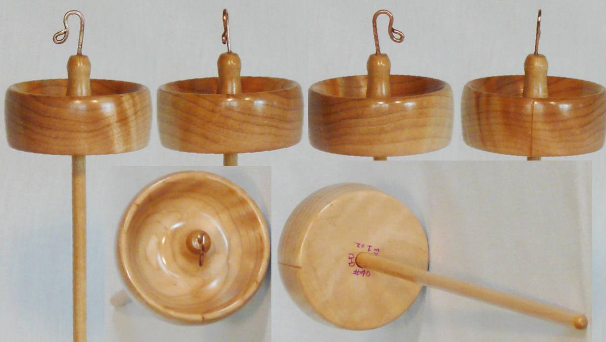 Top whorl drop spindle, hand turned by Cynthia Haney with hand bent copper hook. Wood for whorl is Quilted Maple and the shaft is maple.