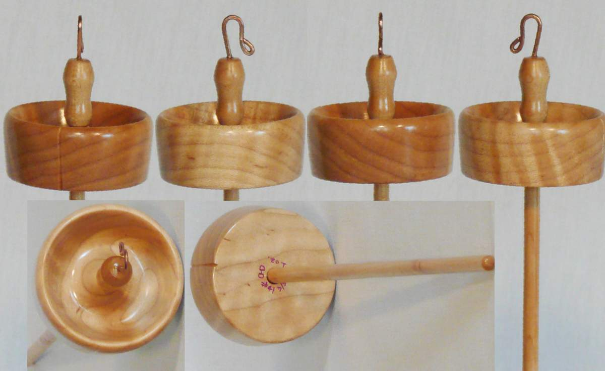 Hand turned top whorl drop spindle by Cynthia D. Haney with a quilted maple whorl and maple shaft.