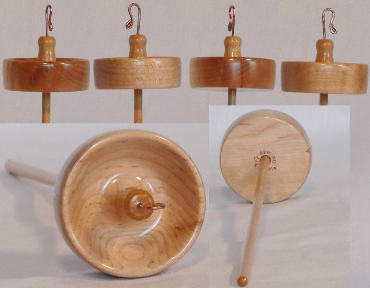 Hand turned drop spindle by Cynthia D. Haney Maple rim weighed whorl on maple shaft