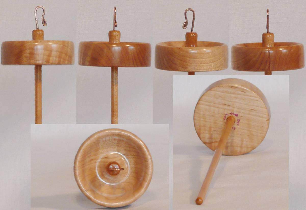 Hand turned drop spindle of quilted maple on maple by Cynthia Haney
