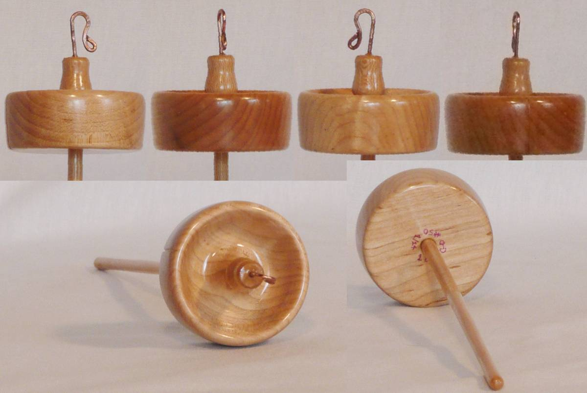Hand turned top whorl drop spindle by Cynthia D. Haney with a Maple whorl on Sycamore shaft