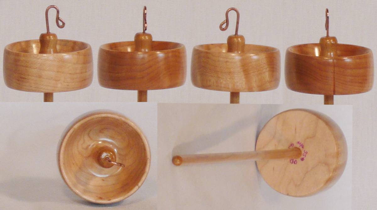 Hand turned top whorl drop spindle by Cynthia Haney with Quilted Maple whorl on a Maple wood shaft