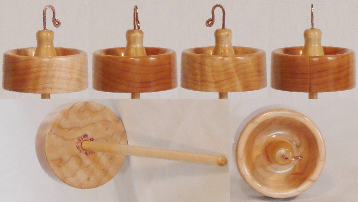 Hand turned top whorl drop spindle by Cynthia Haney with Quilted maple whorl on a Curly Ash shaft.