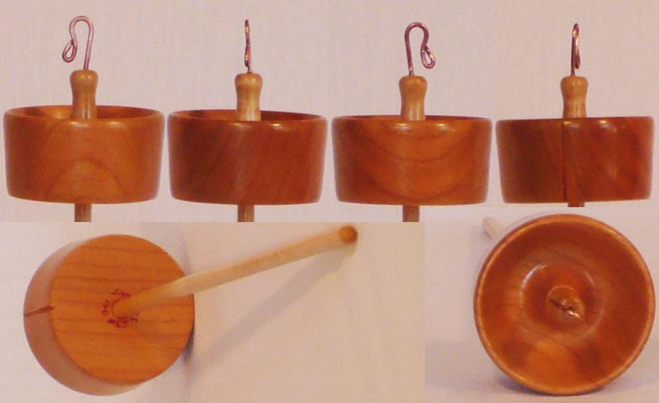 Hand turned top whorl drop spindle by Cynthia Haney with Cherry whorl on a Curly Ash shaft.