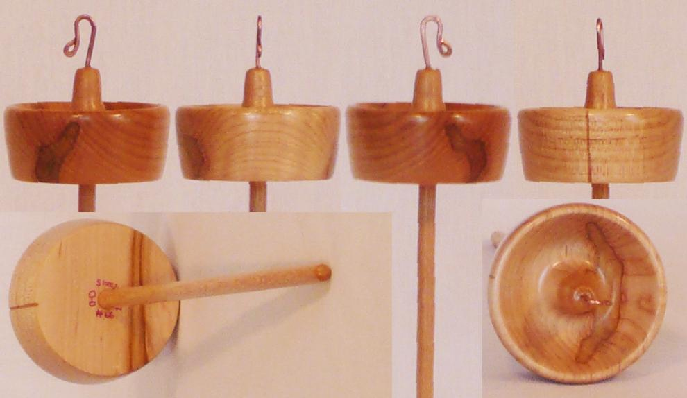 Hand turned top whorl drop spindle by Cynthia Haney with Spalted Maple whorl on a Sycamore shaft.