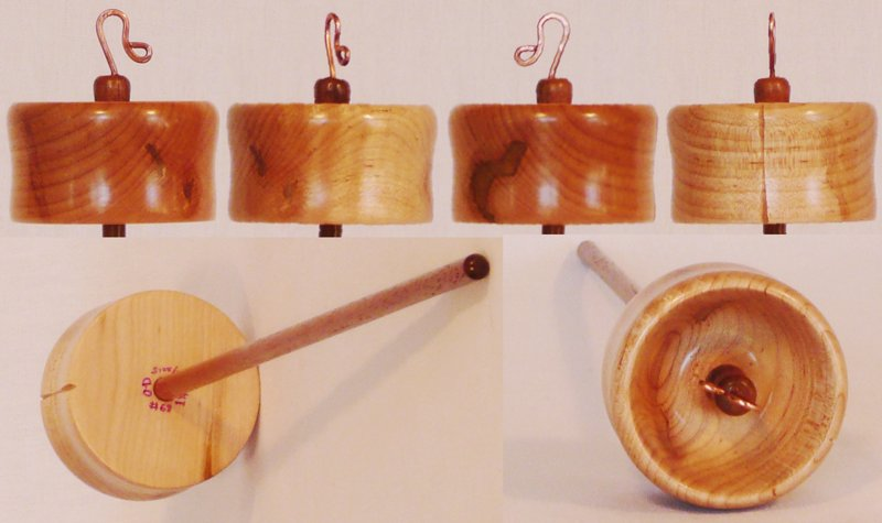 Hand turned top whorl drop spindle by Cynthia Haney with a Spalted and Quilted Maple whorl on a Walnut shaft