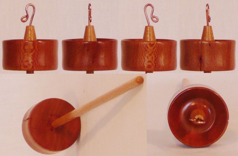 Hand turned top whorl drop spindle by Cynthia Haney with a Sycamore whorl on a Sycamore shaft.