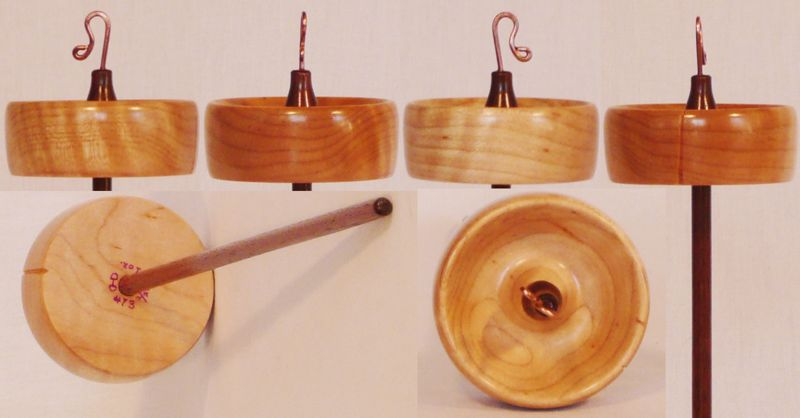 Hand turned top whorl drop spindle by Cynthia Haney with a Quilted Maple whorl on a Walnut shaft.