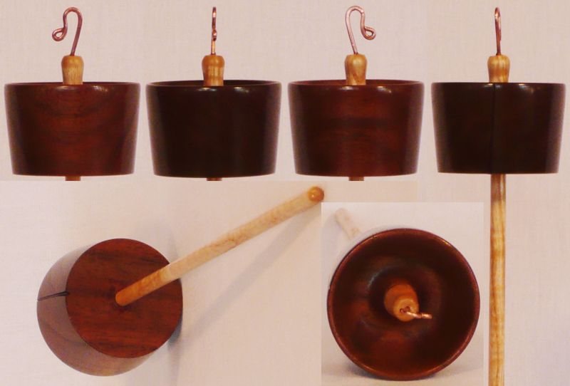 Hand turned top whorl drop spindle of Walnut on Curly Ash by Cynthia Haney.