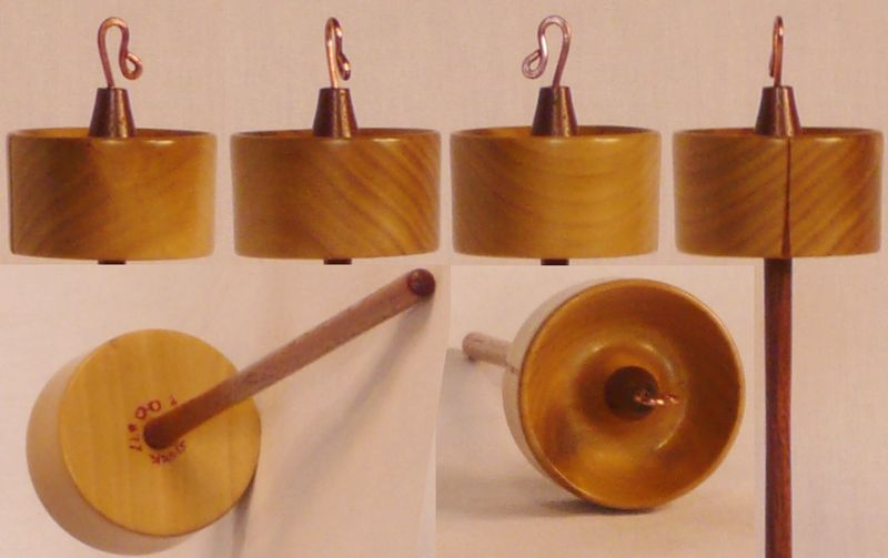 Hand turned top whorl drop spindle of Tulip Poplar on Walnut by Cynthia Haney.