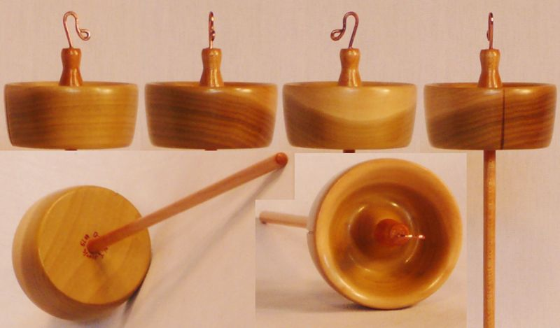 Hand turned top whorl drop spindle of Tulip Poplar on Maple by Cynthia Haney.
