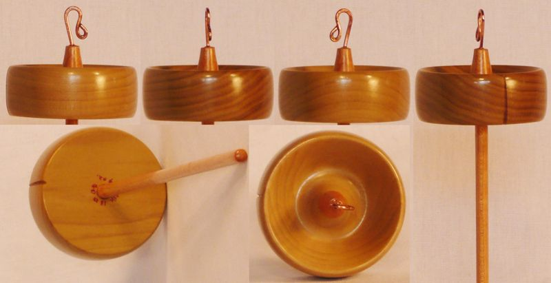 Hand turned top whorl drop spindle by Cynthia Haney with a Tulip Poplar whorl on a Maple shaft.